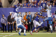 Detroit Lions wide receiver Golden Tate III (15) looks on as Detroit Lions rookie wide receiver Kenny Golladay (19) leaps while trying to catch an incomplete deep pass defended by New York Giants cornerback Dominique Rodgers-Cromartie (41) on a third down play during the 2017 NFL week 2 regular season football game against the against the New York Giants, Monday, Sept. 18, 2017 in East Rutherford, N.J. The Lions won the game 24-10. (©Paul Anthony Spinelli)