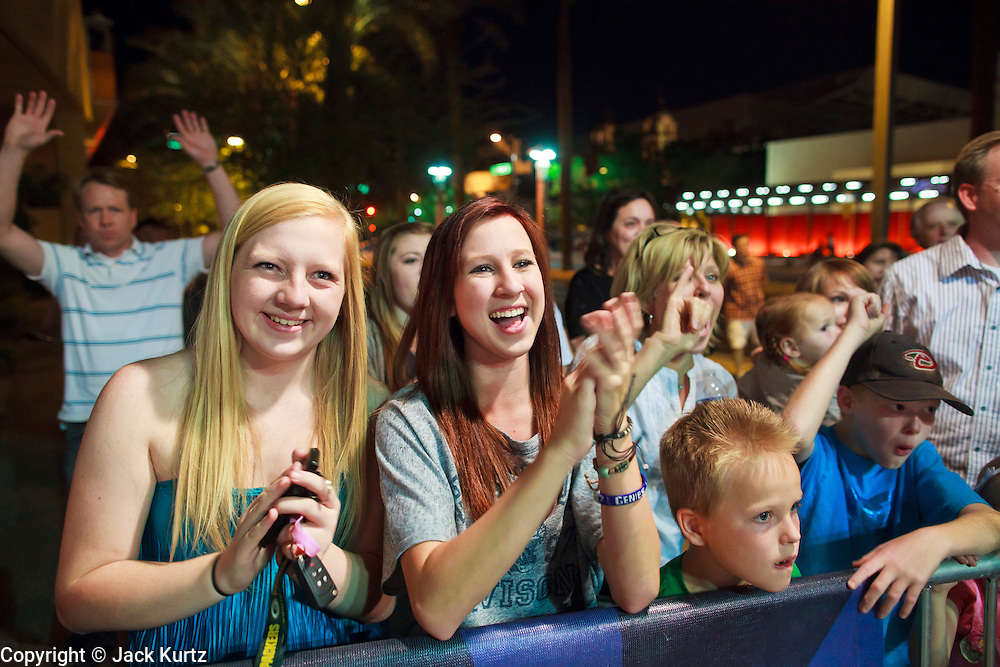 13 MAY 2011 - PHOENIX, AZ: People cheer for Kylee during her concert on the plaza for KPNX. Kylee Saunders is a teen pop sensation in Japan, but a normal high school student in Chandler, where she lives. The teenager has a recording deal with Sony and commutes from Arizona to Japan to promote her records.      PHOTO BY JACK KURTZ