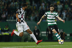 April 22, 2018 - Lisbon, Lisboa, Portugal - Sporting CP Midfielder Bruno Fernandes from Portugal (R) and Boavista FC Defender Robson from Brazil (L) during the Premier League 2017/18 match between Sporting CP and Boavista FC, at Alvalade Stadium in Lisbon on April 22, 2018. (Credit Image: © Dpi/NurPhoto via ZUMA Press)
