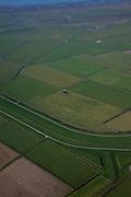 Nederland, Friesland, Gemeente Ferweradeel, 08-09-2009; Noorderleeg (Noarderleech), buitendijks polder en kweldergebied in beheer bij It Fryske Gea (provinciale vereniging voor natuurbescherming). Het gebied is belangrijk als broed-, foerageer- en pleistergebied voor vogels. In het kader van het natuurbeheer experimenteert men met verkweldering van de buitenste zomerpolder, de dijk is gedeeltelijk doorgegraven. Kenmerkend voor het gebied zijn de dobben (dobbe: gegraven poel met drinkwater voor het vee). .Noorderleegte (Northern Void), polders and salt marsh area outside the dikes, managed by It Fryske Gea (Provincial Association for Nature). The area is important for birds (breeding, foraging). As part of the new nature preservation,  the outer dike has been partially dug away allowing for the tides to enter the (former) polders. Caracteristic are the dobben: dug ponds with water for cattle). .luchtfoto (toeslag); aerial photo (additional fee required); .foto Siebe Swart / photo Siebe Swart