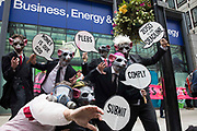 Environmental activists from Corp Rat protest outside the Department for Business, Energy and Industrial Strategy BEIS following an Extinction Rebellion Stop The Harm march on the fourth day of Impossible Rebellion protests on 26th August 2021 in London, United Kingdom. Extinction Rebellion are calling on the UK government to cease all new fossil fuel investment with immediate effect.