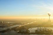 Nederland, Noord-Holland, Amsterdam, 11-12-2013; Einsteinweg (Ring A10) ter hoogte van Noordzeekanaal en Coentunnel. Centrale Hemweg aan de horizon in tegenlicht en met zonsondergang.<br /> Ringroad Amsterdam and electricity plant at sunset. <br /> luchtfoto (toeslag op standaard tarieven);<br /> aerial photo (additional fee required);<br /> copyright foto/photo Siebe Swart.