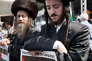 A small group of orthodox Jews show their support of Gaza and the call to end the Israeli siege of Gaza.<br /> <br /> Tens of thousands of protesters marched in Central London to show their outrage against the Israeli onslaught on Gaza.