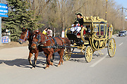 PINGLIANG, CHINA - DECEMBER 27: (CHINA OUT) <br /> <br /> 90,000 RMB Assembled Royal Carriage Attracts Tourists<br /> <br /> Bai Dijun drives his assembled carriage on the road on December 27, 2015 in Pingliang, Gansu Province of China. 46-year-old Bai Dijun spent about 90,000 RMB (13,878 USD) buying and assembling a royal carriage in Pingliang. Bai took tourists with the carriage and performed with it in some commercial events. <br /> ©Exclusivepix Media