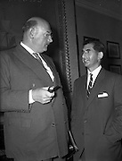 21/05/1959<br /> 05/21/1959<br /> 21 May 1959<br /> Associated Chamber of Commerce Annual General Meeting at the Commercial Buildings, Dame Street, Dublin. Mr. M. Maguire (left) and Mr. L. Fine, President and Vice-president respectively of the Limerick Chamber of Commerce seen chatting at the meeting.