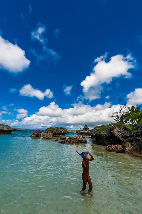 Kanak children playing at the beach, Roh Seday Home Stay, North Bay, island of Mare, Loyalty Islands, New Caledonia