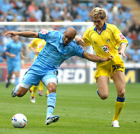 Photo: Ed Godden.<br />Coventry City v Leeds United. Coca Cola Championship. 16/09/2006. Coventry's Leon McKenzie (L) is challenged by Matthew Kilgallon.