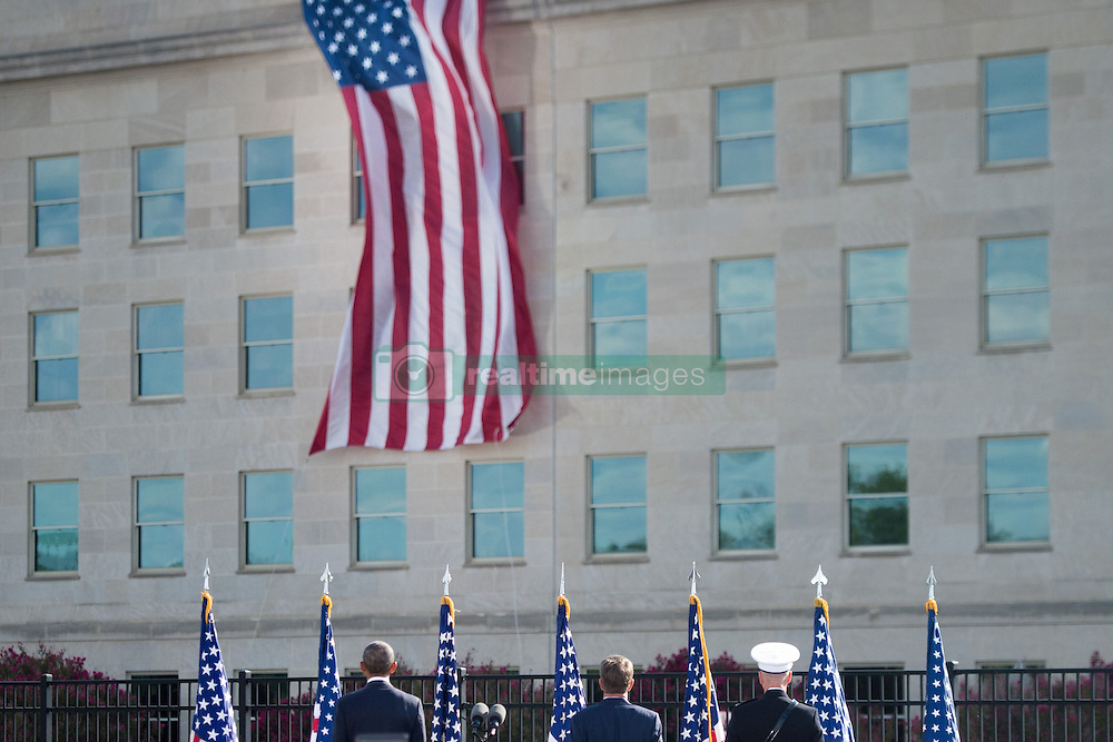 September 11, 2016 - Arlington, VA, United States of America - U.S President Barack Obama, Defense Secretary Ash Carter, and Joint Chiefs Chairman Gen. Joseph F. Dunford Jr., render honors to the flag during a remembrance ceremony commemorating the 15th anniversary of the 9/11 terrorist attacks at the Pentagon September 11, 2016 in Arlington, Virginia. (Credit Image: © Po2 Dominique A. Pineiro/Planet Pix via ZUMA Wire)