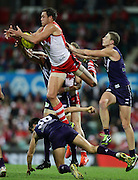 Shane Mumford of the Swans climbs high for the ball during the 2013 AFL round 08 match between the Sydney Swans and the Fremantle Dockers at the SCG, Sydney on May 18, 2013. (Photo: Craig Golding/AFL Media)
