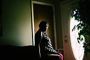 """LOWNDES COUNTY, AL – JULY 10, 2017: Perman Hardy, 58, sits in the living room of her home that was construction in 1989 with a below ground septic tank. Hardy, a former home health nurse, has had trouble with her septic tank backing up into the house since her first year in the home, and says she's just learned to live with it. """"The first time it happened, we had to leave the house for two weeks because [sewage] was everywhere. It was in every room in the house.""""<br /> <br /> A recent study conducted by Baylor University suggests that nearly one 1 in 3 people in Lowndes County have hookworm, a parasite normally found in poor, developing countries. Below ground septic tanks are common in Lowndes, but due to the chalky clay soil throughout much of the Black Belt, septic tanks are prone to backing up into people's homes during heavy rains. With failing or absent municipal sewage systems in the county, many families choose to live with open, above ground sewer systems made from PVC pipe, which pump raw sewage into nearby streams or open land."""