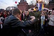 Moscow, Russia, 13/03/2005..Russians dance to traditional music on Vasilevsky Spusk by Red Square as they celebrate the  final day of Maslenitsa, or Pancake Week, a Russian holiday which dates back to pagan times and marks the official end of winter.