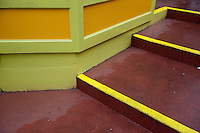 Colorful steps and building on a rainy street.