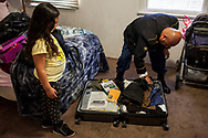 U.S. Army veteran Hector Barajas-Varela unpacks his belongings during his first day back home as a U.S. citizen in Compton, California, Friday, April 13, 2018. Barajas Varela spent a total of 14 years deported in México.