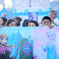Youngsters peek over the upright of a Frozen-themed float during the Tohatchi High School Homecoming parade in Tohatchi Wednesday.