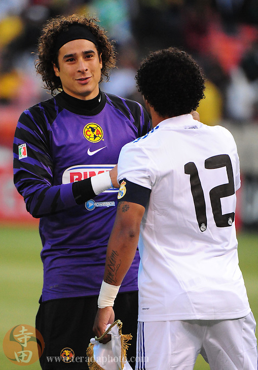 August 4, 2010; San Francisco, CA, USA; Club America goalkeeper Guillermo Ochoa (left) shakes hands with Real Madrid defender Marcelo (12) before the international friendly match at Candlestick Park. Real Madrid defeated Club America 3-2. Mandatory Credit: Kyle Terada-Terada Photo