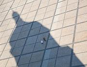 Shadow of the belltower of Saint Sophia Cathedral across Bohdan Khmelnytsky.Square. Kiev, Ukraine, 2007