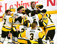 NASHVILLE, TN - JUNE 11:  The Pittsburgh Penguins storm the ice in celebration of defeating the Nashville Predators 2-0 in Game Six of the 2017 NHL Stanley Cup Final at the Bridgestone Arena on June 11, 2017 in Nashville, Tennessee.  (Photo by Frederick Breedon/Getty Images)