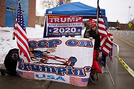 Nancy and Calvin Pemberton, supporters of U.S. President Donald Trump hang a banner outside a site for Trump's rally taking place the next day, in Des Moines, Iowa, U.S., January 29, 2020. REUTERS/Rick Wilking