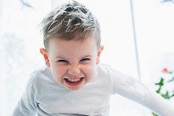 Close- up of little boy gritting his teeth in anger