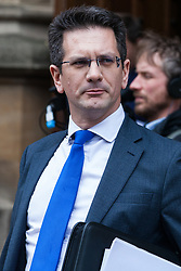 London, UK. 15th November, 2018. Steve Baker, Conservative MP for Wycombe, listens to Jacob Rees-Mogg, Conservative MP for North-East Somerset, who appeared at a press conference outside the House of Commons to announce the sending of a letter of no confidence in Prime Minister Theresa May following the Cabinet resignations of Brexit Secretary Dominic Raab and Work and Pensions Secretary Esther McVey and the day after the Prime Minister gained Cabinet approval of a draft Brexit agreement .