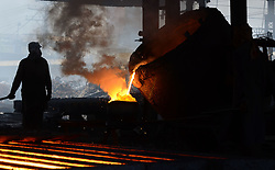 April 28, 2017 - Lahore, Punjab, Pakistan - Pakistani laborers work by a smelter at an iron factory. As the world marks International Labor Day on May 1st, International Labor Day, commemorates the historic struggle of working people throughout the world. (Credit Image: © Rana Sajid Hussain/Pacific Press via ZUMA Wire)