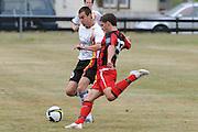 Michael Gwyther of Waikato and Jordan Swaney of Canterbury compete for the ball. NZFC Championship Soccer - Waikato v Canterbury, Centennial Park, Ngaruawahia. Sunday, 24 January 2010. Photo: Geoffrey Dickinson/PHOTOSPORT