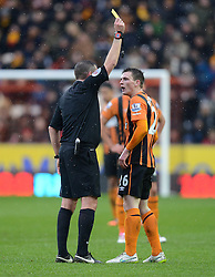 Referee Phil Dowd shows a yellow card to Hull City's Andrew Robertson - Photo mandatory by-line: Richard Martin-Roberts/JMP - Mobile: 07966 386802 - 31/01/2015 - SPORT - Football - Hull - KC Stadium - Hull City v Newcastle United - Barclays Premier League