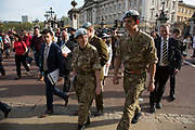 After a garden party at Buckingham Palace, military and civilian attendees happily leave after their royal experience in London, United Kingdom.