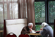 An elderly couple eat lunch at the Cherish-Yearn retirement community on the outskirts of Shanghai, China, on Tuesday, Dec. 13, 2011. China has about  36000 institutions and 2.7 million beds serving the elderly, enough for 1.6 percent of the population over 60, according to the World Bank.