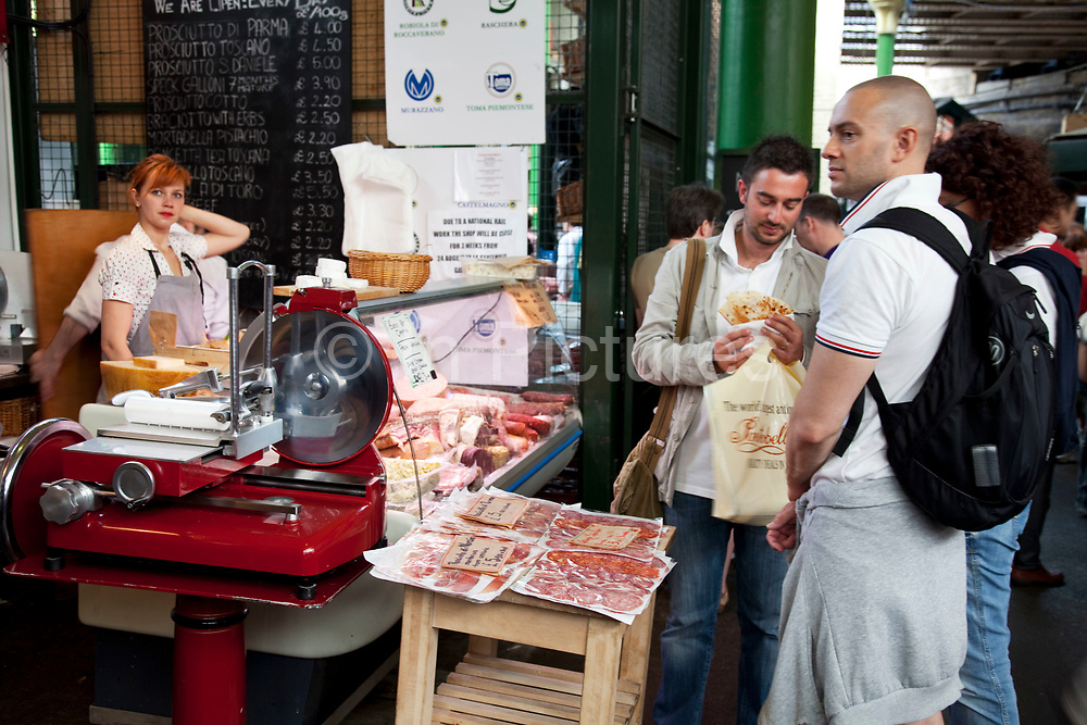Cured meat stall. Borough Market is a thriving Farmers market near London Bridge. Saturday is the busiest day.