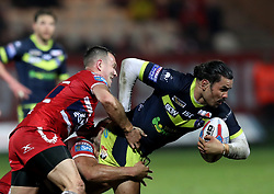 Wakefiekd Trinity's Justin Hero (right) is tackled during the Betfred Super League match at Craven Park, Hull.