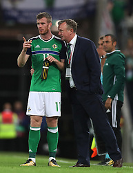 Northern Ireland manager with Chris Brunt during the 2018 FIFA World Cup Qualifying, Group C match at Windsor Park, Belfast. PRESS ASSOCIATION Photo. Picture date: Monday September 4, 2017. See PA story SOCCER N Ireland. Photo credit should read: Brian Lawless/PA Wire. RESTRICTIONS: Editorial use only, No commercial use without prior permission.