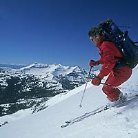 SKIING, Big Sky, Montana. Meg O'Leary (MR) skiing Liberty Bowl on Lone Peak's South Face.