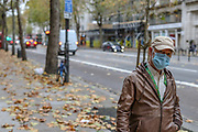 "People some of them wearing a face-covering mask walks across central London on Wednesday, Nov 11, 2020. <br /> In times when a pandemic unleashes death and poverty, the concept of what is essential to keep society functioning in a lockdown is gripping Europe.<br /> Services of remembrance on ""Armistice Day"" are held in many nations on Wednesday will commemorate the 102nd anniversary of the armistice ending World War I and honouring all those who died in the war. (VXP/ Vudi Xhymshiti)"
