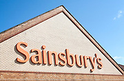 Close up of Sainsbury's supermarket store sign, Chippenham, Wiltshire, England, UK