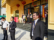 """13 FEBRUARY 2019 - SIHANOUKVILLE, CAMBODIA: Supervisors of Cambodian workers at the BWin Casino, a newly opened casino in downtown Sihanoukville, give a debriefing at the end of their overnight shift at the casino. There are about 80 Chinese casinos and resort hotels open in Sihanoukville and dozens more under construction. The casinos are changing the city, once a sleepy port on Southeast Asia's """"backpacker trail"""" into a booming city. The change is coming with a cost though. Many Cambodian residents of Sihanoukville  have lost their homes to make way for the casinos and the jobs are going to Chinese workers, brought in to build casinos and work in the casinos.      PHOTO BY JACK KURTZ"""