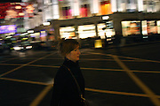 Woman crossing the road at Oxford Circus, in central London, one of the busiest areas of the city, on Tuesday, Dec. 21, 2004. **ITALY OUT**