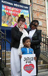 Tottenham, London, August 4th 2015. Family, friends and supporters of alleged gangster Mark Duggan, who was shot and killed by police on 4th August 2011 in Tottenham, commemorate his death which led to widespread uprisings and riots, by marching from Broadwater Farm estate to Tottenham police station. His family is demanding a public inquiry into the role of Operation Trident, set up to fight gun and knife crime amongst the black community, whose officers they accuse of putting guns out on the streets of London. PICTURED: Mark Duggan's Mother Pamela sheds a tear as a minute's silence is held in his memory. // Contact: paul@pauldaveycreative.co.uk Mobile 07966 016 296