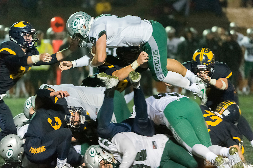Granite Bay Grizzlies Evan Tattersall (9), dives for a first down during the fourth quarter as the Oak Ridge High School Trojans host the Granite Bay Grizzlies, Friday Oct 14, 2016. The Oak Ridge Trojans won the game 28-0.<br /> photo by Brian Baer