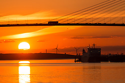 © Licensed to London News Pictures. 03/06/2015.  Dartford, Kent. A stunning Thames sunset behind the QEII Bridge which links Dartford in Kent with Thurrock in Essex. A short heatwave is predicted for this week. Credit : Rob Powell/LNP