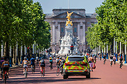 Police patrol past people Enjoying cycling on The Mall as the sun comes out again. The 'lockdown' continues for the Coronavirus (Covid 19) outbreak in London.