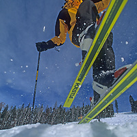 A young skier jumps off a bump at Montana's Big Sky resort.
