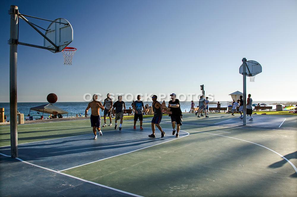 Playing Basketball at the Beach at Sunset in Laguna Beach California