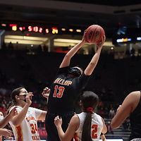 Gallup Bengal Cheyenne John (13) grabs a rebound in the paint against the Espanola Valley Sundevils during the New Mexico Class 4A girls basketball championship game at The Pit in Albuquerque Saturday. The Bengals defeated the Sundevils 63-51 to become New Mexico Class 4A state champions.