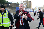 a wind swept Sir Alex Ferguson, the Former Manchester United manager arrives at Stamford Bridge before k/o. Barclays Premier league match, Chelsea v Manchester Utd at Stamford Bridge in London on Sunday 7th February 2016.<br /> pic by John Patrick Fletcher, Andrew Orchard sports photography.