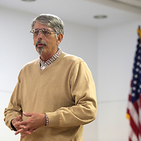 """030515      Cayla Nimmo<br /> <br /> Local author John Lewis Taylor talks about his book, """"Looking for Dan,"""" at a reception held at the Octavia Fellin Library in Gallup Thursday."""