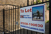 2 months before the London Olympics, a To Let sign is attached to the gates of a building offering space near to the 2012 Olympic Park site. Merely a mile from the main Olympic Park site that is due to attract thousands of international interest. The 500-acre Olympic Park is the largest recreational space to open in Europe for 150 years. More than £9 billion of public money has been pumped into the area and yet some building owners with property on the periphery of the Olympic venues have left their buildings empty, hoping for last minute offers.