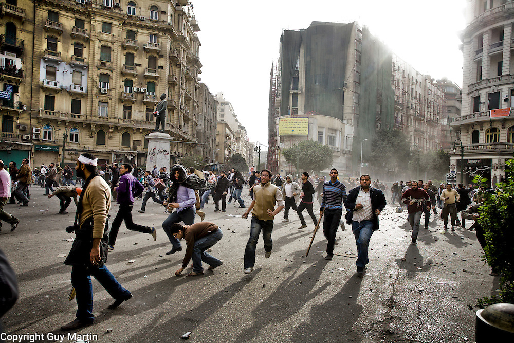 Anti-government protesters fight with pro-government supporters, using rocks and stones, in the streets around Tahrir Square. 25 January 2011 saw the beginning of a nationwide 18 day protest movement that eventually ended the 30-year rule of Hosni Mubarak and his National Democratic Party..