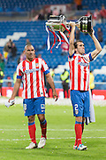 Cata Diaz and Godin offering cup to supporters