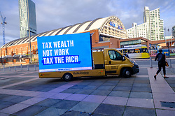 © Licensed to London News Pictures. 04/10/2021 Manchester, UK. Partners In Progress, a network of UK millionaires challenges the Chancellor to Tax The Rich, with a rolling billboard outside Conservative Party Conference. Photo credit: Jess Hurd/LNP